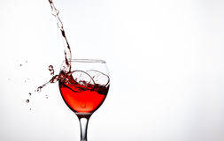A glass with pink wine and sprays. One glass with pink wine and sprays Royalty Free Stock Photo