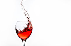 A glass with pink wine and sprays. One glass with pink wine and sprays Stock Images
