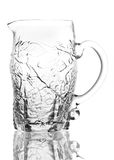 Glass pitcher. Empty Glass pitcher on white background Stock Photography