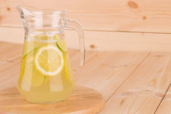 Glass pitcher full of fresh cold tasty lemonade. Stock Photography