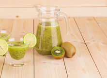 Glass pitcher full of fresh kiwi smoothie. Stock Photography
