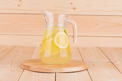 Glass pitcher full of lemonade. Stock Photos