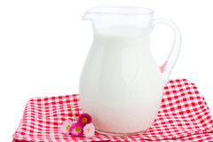 Glass pitcher full of milk Stock Photos