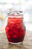 Glass pitcher with herbal juice. Stock Photos