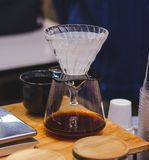 Glass pitcher make drip Coffee. At shop Stock Image