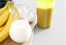 Glass pitcher of milk. On table Royalty Free Stock Images