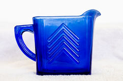 Glass Pitcher. A vintage blue glass pitcher Stock Photo