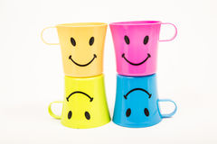 Glass, plastic smile. Glass,Plastic smile set for picnic in many colors on white Stock Photography