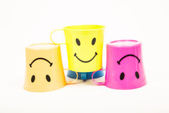 Glass, plastic smile. Glass,Plastic smile set for picnic in many colors on white Royalty Free Stock Photo