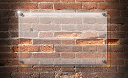 Glass Plate on Brick Wall Background Royalty Free Stock Photography