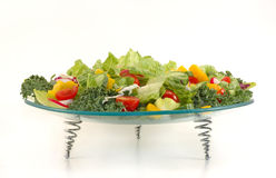 Glass plate full with vegetables . Healthy salad mix. Stock Images