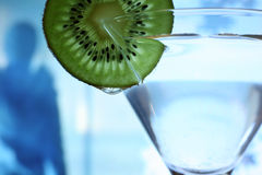 Glass with a plate kiwi Royalty Free Stock Photos