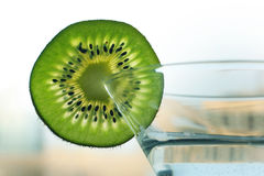 Glass with a plate kiwi Royalty Free Stock Image