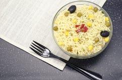 Glass plate of noodles on dakr background stock image