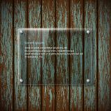 Glass plate on old wooden wall Royalty Free Stock Photography
