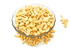Glass plate with peanuts. On white background Royalty Free Stock Photos