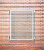 Glass plate on red brick Royalty Free Stock Image