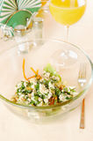 Glass plate with salad on the table Stock Photography