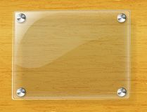 Glass plate on wood background Stock Image