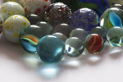 Glass playing marbles, different color. Royalty Free Stock Image