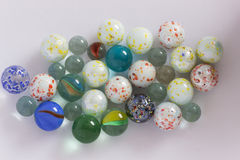 Glass playing marbles different colors. Royalty Free Stock Images