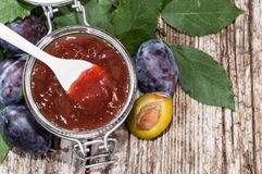 Glass with Plum Jam on wood Stock Photos