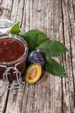 Glass with Plum Jam on wood Royalty Free Stock Image