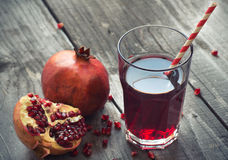 Glass of pomegranate juice Royalty Free Stock Images
