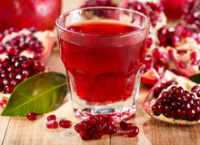 Glass of pomegranate juice with fresh fruits royalty free stock photo