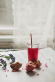 Glass of pomegranate juice with fresh fruits on wooden table Stock Photos