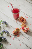 Glass of pomegranate juice with fresh fruits on wooden table Stock Photography