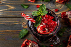 Glass of pomegranate juice with fresh pomegranate fruits Stock Image