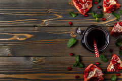 Glass of pomegranate juice with fresh pomegranate fruits Royalty Free Stock Image