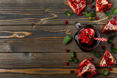 Glass of pomegranate juice with fresh pomegranate fruits Stock Photography