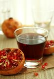 glass of pomegranate juice and pomegranate Stock Photos