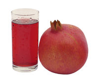 A glass of pomegranate juice and pomegranate Royalty Free Stock Photos