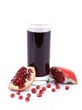 Glass of pomegranate juice with sliced fruits Royalty Free Stock Photography