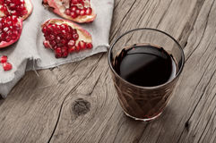 Glass of pomegranate juice with slices of pomegranate Royalty Free Stock Photo