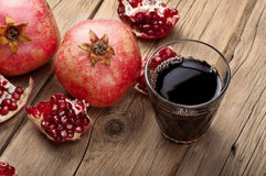 Glass of pomegranate juice with slices of pomegranate Royalty Free Stock Image