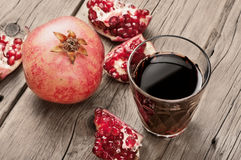 Glass of pomegranate juice with slices of pomegranate Stock Image