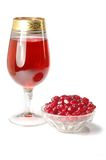 Glass of pomegranate juice on white background Stock Photo