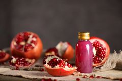 Glass of pomegranate seed body scrub. On a wooden surface. Closeup stock images