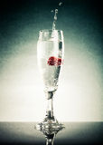 Glass of pop, raspberry and splashes on a light background. With Royalty Free Stock Photography
