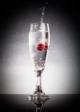 Glass of pop, raspberry and splashes on a light background. With Royalty Free Stock Photo