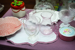 Glass and porcelain tableware is on the table Stock Photography