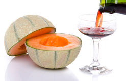 Glass of porto wine with a melon cut in half Royalty Free Stock Photography