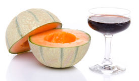 Glass of porto wine with a melon cut in half Royalty Free Stock Photos