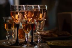 Glass with portuguese 10 year old tawny porto wine standing on the barrell in the restaurant in vineyard.  stock photography