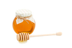 Honey in glass pot and stick Royalty Free Stock Photos