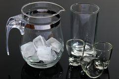 Glass pot and glasses Stock Photos